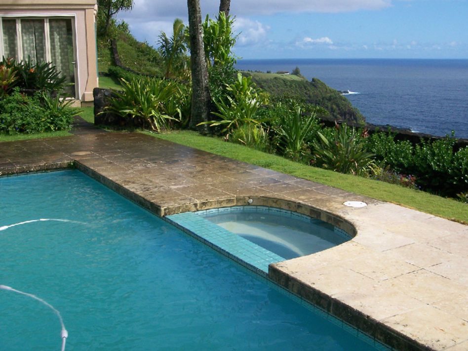 Island Wide Natural Stone & Tile Tile Restoration along Swimming Pool